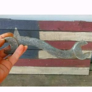 Antique tractor wrench curved handle